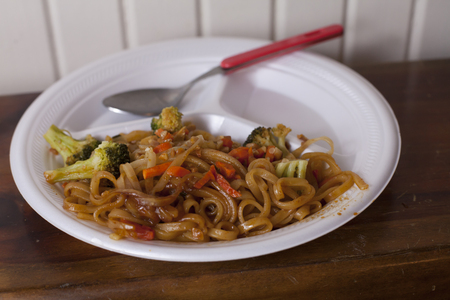 Large portion of fried Chinese noodles and a spoon