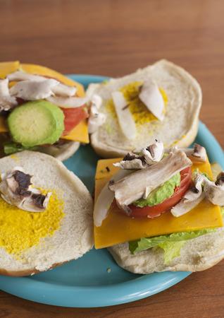 Avacado and mushroom slices on a veggie burger