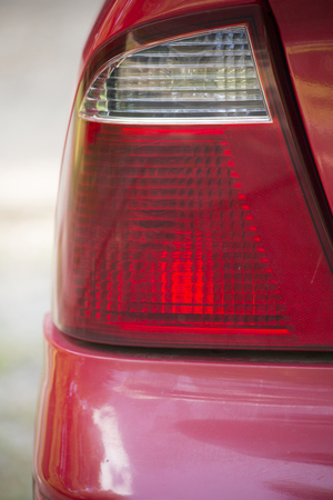 Close up of an unlit rear driver's side taillight