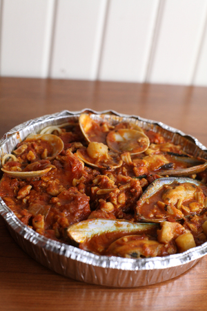 Huge tin of baked seafood and pasta marinara