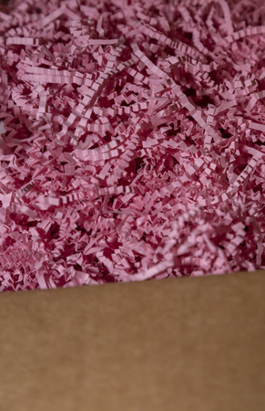 Vertical image of pink packing paper and wrap in a box Stok Fotoğraf