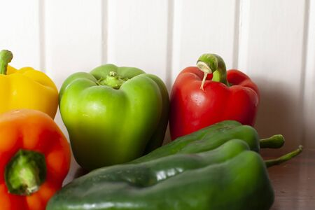 Yellow, green, red, and orange bell peppers with a pair of poblano peppers Stock Photo