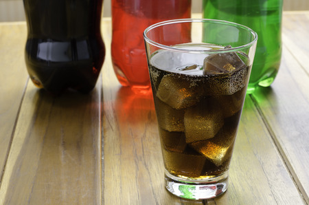 icecubes: A glass of cola with ice cubes