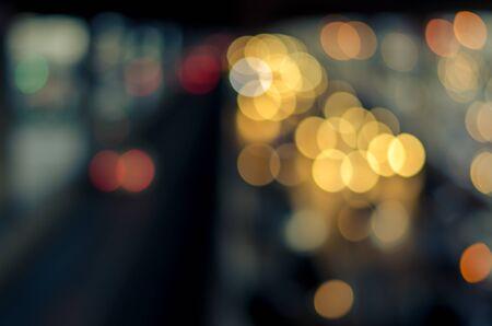 defocussed: Blurred night light traffic in Bangkok city, Thailand. Abstract defocussed background. Split toning effect.