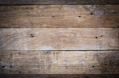 Wooden table background with vignette, top view from above.