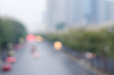 defocussed: Blurred light traffic in the evening on the road in Bangkok city, Thailand. Abstract defocused cityscape background.