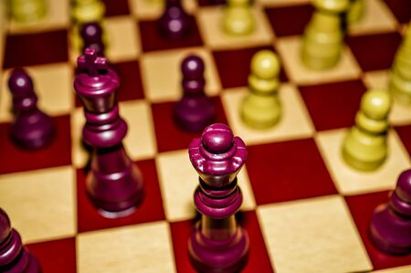 king and queen: Chessboard with king, queen, and pawns Stock Photo