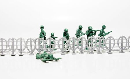 Plastic green toy soldiers in combat