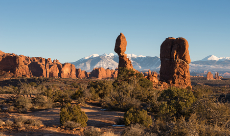 Balanced Rock with the back drop of Arches, Rock Formations and the La Salle Mountains. Stock Photo