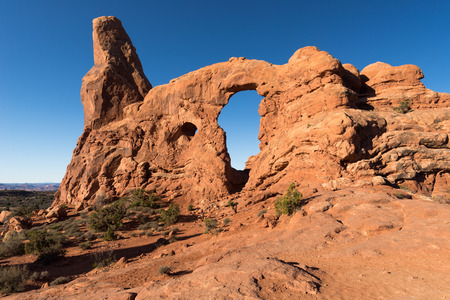 Turret Arch with one of the many trails that lead to these monuments within Arches National Park. Stock Photo