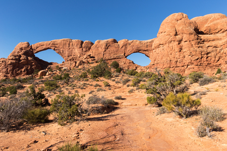 South and North Window Arch is located in Arches National Park Utah Stock Photo