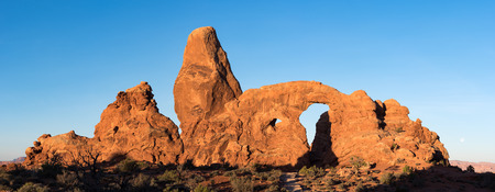 Turret Arch is located within the Arches National Park in South Eastern Utah. This panorama of the geologic spender that dominates this national park. Banco de Imagens