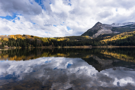 This is a view from Lost Lake Campground which offers a grand view and reflection of East Beckwith Mountain in Lost Lake Slough. Lost Lake Campground is located near Crested Butte and North of Gunnison Colorado.
