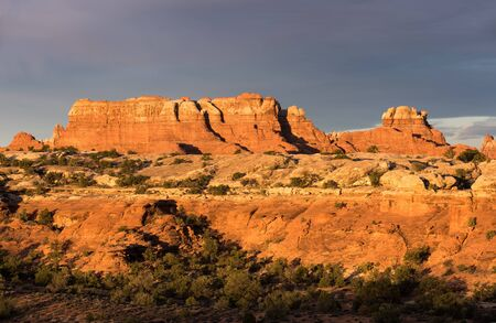 Early morning light on red rock formations within the Needles District of Canyonlands National Park, Utah.