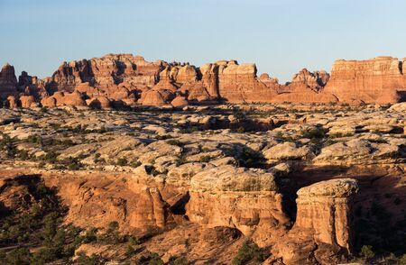 Pinnacles rise above the desert landscape within the Needles District of Canyonlands National Park, Utah.