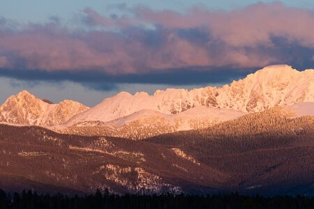 The west side of the Indian Peaks at sundown viewed from the Fraser Valley.  The towns of Tabernash and Fraser are below the Indian Peaks Wilderness area.