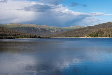 Looking north to the dam on Long Draw reservoir with surrounding mountains and next to Rocky Mountain National Park.