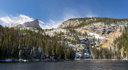 12,713 foot Hallet Peak rises above Bear Lake in Rocky Mountain National Park, Colorado. Standard-Bild