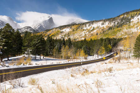 12,713 foot Hallet Peak and 12,324 foot Flattop Mountain after an early Fall snow storm.  A scenic paved road takes visitors through the rich scenic views of Rocky Mountain National Park in Colorado. Editorial