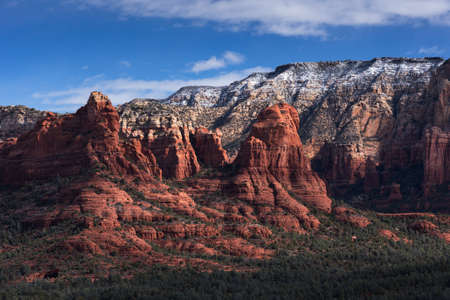Rising above Devil's Kitchen on the lower left side are the dramatic Red Rock Formations that dominate the skyline around Sedona Arizona.