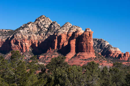Coffee Pot Rock Formation within Coconino National Forest, Arizona.  The Red Rock formations rise above Western Sedona in dramatic formation.