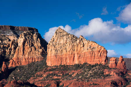 Ship Rock or Sail Rock,  rises above Sedona as a prominent landmark within Coconino National Forest.