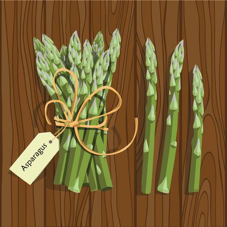 Tige de légume d'asperge. Bouquet de pousses d'asperges vertes fraîches. Alimentation saine, régime, conception de recettes de salade végétarienne.