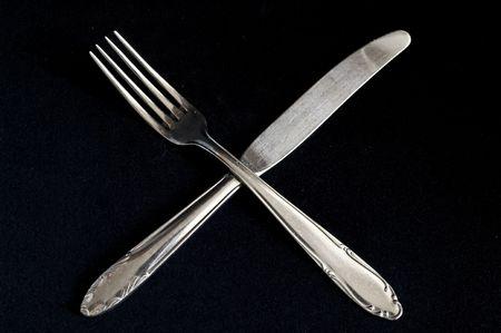Fork and knife on black background