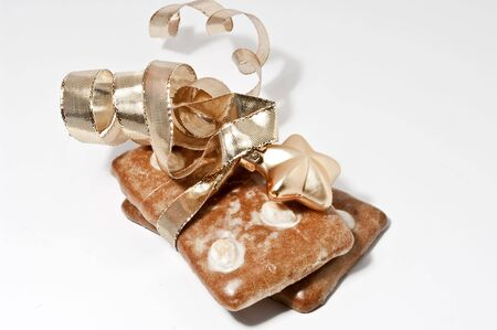 Gingerbread cookies and golden ribbon photo