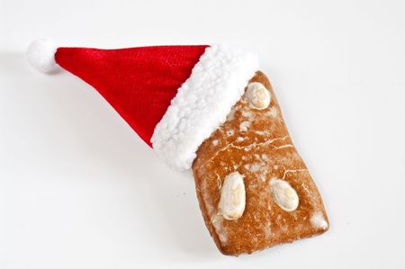 Gingerbread cookie and santa hat photo