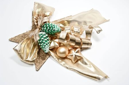 cone shaped: Golden bow and green pine cone shaped christmas tree balls Stock Photo