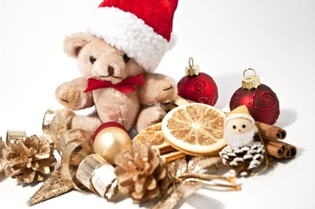 Little teddy and christmas decoration photo