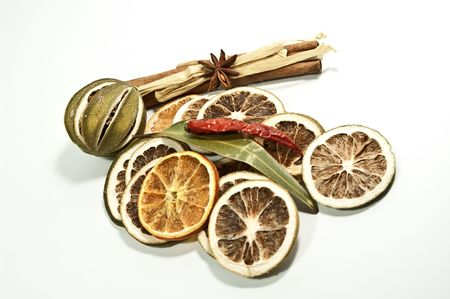 Dried citrus fruits with cinnamon photo