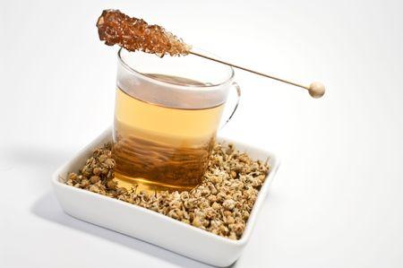 german chamomile: Chamomile tea and chamomile blossoms