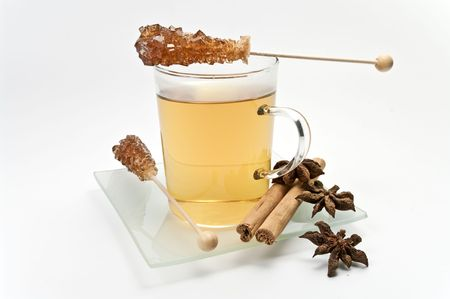 german chamomile: Glass cup with chamomile tea