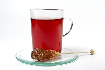 rea: Glass cup with rea tea and rock candy Stock Photo