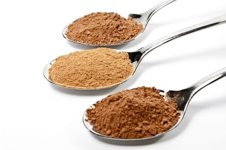 Spoons with cacao and cinnamon