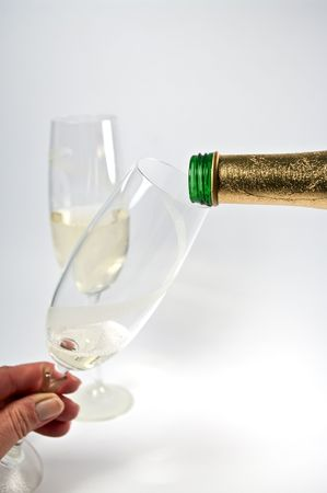 ure: Pouring sparkling wine in a glass