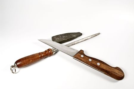 Kitchen knife and stone for sharpening Stock Photo