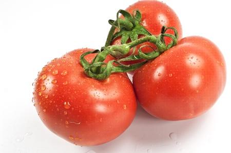 tomatos: Three ripe tomatos Stock Photo
