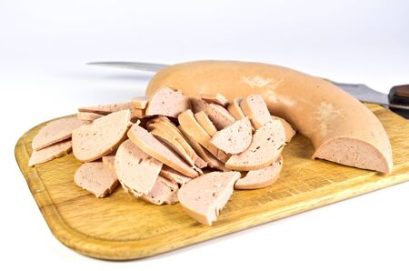 Stripped sausages on a wooden board