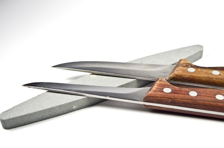 Two kitchen knife and a whetstone Stock Photo