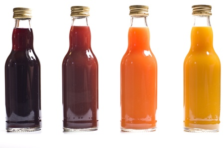 Four bottles with fruit juice