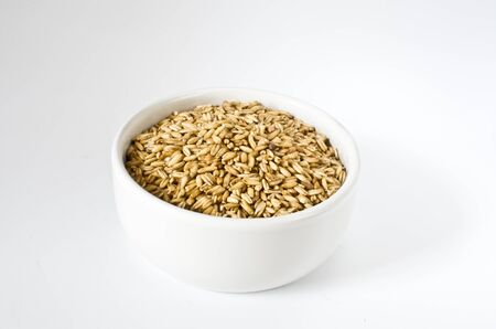 Oat in a white bowl Stock Photo - 12137297