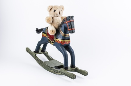 Teddy and rocking horse photo