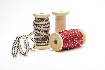 Wooden spool with ribbon