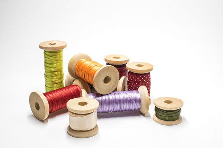 Spools with satin ribbon