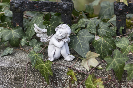 Angel and ivy Stock Photo