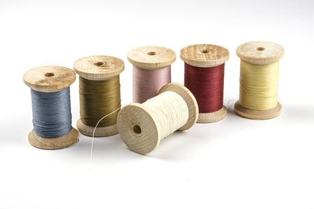 Row of thread spools