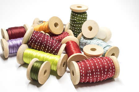 Colored ribbons on wooden spools Stock Photo